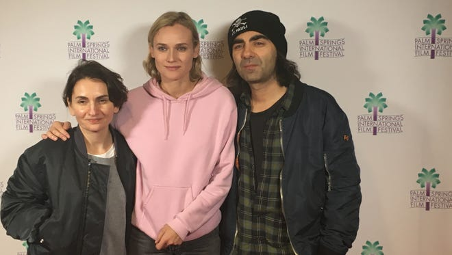 'In the Fade' producer Nurhan Sekerci-Porst, lead actress Diane Kruger and director Fatih Akin pose in front on the Palm Springs High School Auditorium.