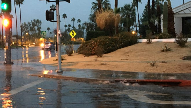 Flood water accumulates at the corner of East Palm Canyon Drive and Sunrise Way in Palm Springs earlier this year. But the region remains in a rain deficit when compared with average precipitation.
