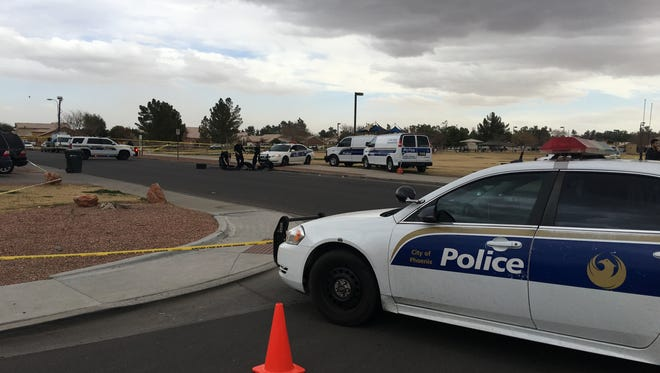 Phoenix police investigate a scene where two bodies were found in a car on Jan. 9, 2018.