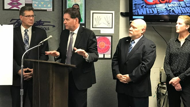 Consultant George Kacan (from left), Farmington Hills City Manager Dave Boyer, Mayor Ken Massey and Director of Special Services Ellen Schnackel made a pitch last month about the potential purchase of Harrison High School.