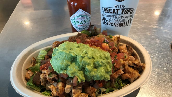 At Chipotle, customers can create their own bowls. Here's an example:  fajita veggies, steak and chicken, pico de gallo, guacamole and sour cream. Add the heat with some complimentary Tabasco sauce.