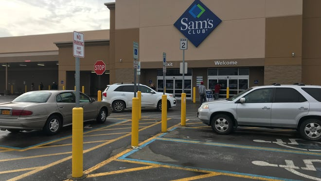 Frustrated shoppers outside the Henrietta Sam's Club, which was closed Thursday and will be shuttered for good Jan. 26