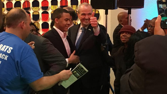 Gov.-elect Phil Murphy gives a thumbs up to supporters at his inauguration kickoff at Newark Museum.