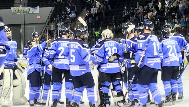 The Ice Flyers celebrate their 5-2 win Friday night against Birmingham Bulls