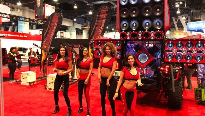 Ivette Flores, right, and other models at the Orion Car Audio booth at CES 2018 in Las Vegas. The use of provocatively dressed paid models has decreased at the large trade show, but some women in technology said they wish it would stop altogether.