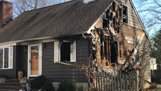 Heave fire damage is seen on Monday, Jan. 15, 2015, after a  Saturday night fire at the corner or Joseph Street and Shunpike Road in Chatham Township.