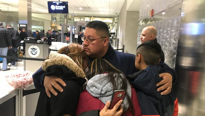 Jorge Garcia, 39, of Lincoln Park, hugs his wife, Cindy Garcia, and their two children at Detroit Metro Airport on Jan. 15, 2018, moments before boarding a flight to Mexico. He was ordered deported after living in the U.S. since he was 10 years old, brought to the U.S. by undocumented immigrants.