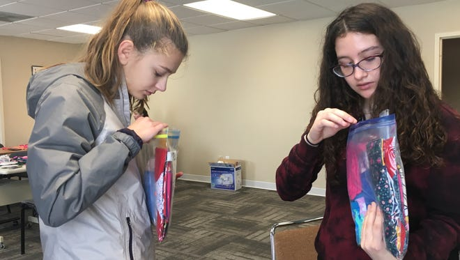 Reese Dial, a sophomore at Urbandale High School, and Mary Ann Schwinet, a sophomore at Roosevelt and Central Academy, put together feminine hygiene packs to give girls around the world on Monday, Jan. 15, 2018, in Des Moines. The teens were participating in Days for Girls, a project at Community Youth Concepts in Des Moines that provideswashablehygiene products to girls around the world.