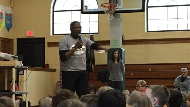 Kevin Watkins, president of the Port Huron NAACP chapter, talks with Garfield Elementary students during a Martin Luther King Jr. Day assembly on Monday, Jan. 15, 2018.