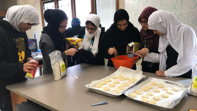 Students at Noor-Ul-Iman School in South Brunswick did not have a day off on Martin Luther King Jr. Day. Instead, it was a day on, as students, such as these eighth-graders, participated in community service and civil engagement education. The eighth-graders baked cookies and wrapped utensil packages for various nonprofit organizations.