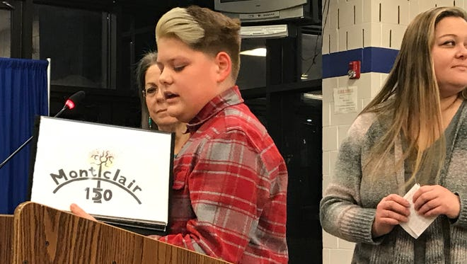 Dylan Baddeley, a seventh-grader at Glenfield Middle School in Montclair, displays his winning entry in the township's 150th anniversary logo contest at the Jan. 10 Board of Education workshop.