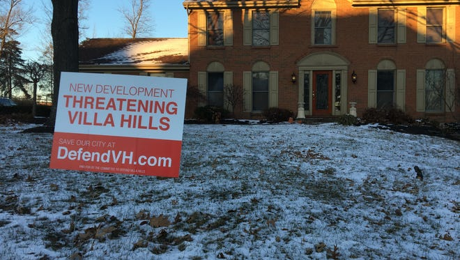 """A home on Carpenter's Trace in Villa Hills, near where a planned residential and retail development has been proposed, displays a """"Defend Villa Hills"""" yard sign."""
