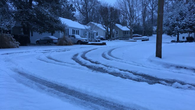 Maplemere Drive at about 7 a.m. Tuesday morning, after another 3 inches of snow fell across Clarksville.