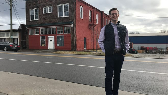 Developer Joe Fox stands in front of a building at 1520 Washington Avenue. The building will be renovated and the second floor will serve as a branch office for Fox & Fogarty's real estate company.