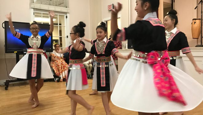 Members of the Nkauj Hmoob Paj Tshua Nplaim dance group perform at the 5th annual MLK dinner on Jan. 15, 2018.