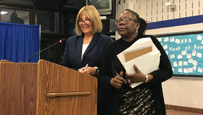 Barbara Pinsak, left, and Felice Harrison-Crawford of the Montclair School District stand at the podium during the Jan. 10 Montclair Board of Education meeting.