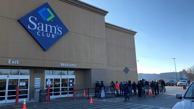 A line of shoppers wait for entry to a soon-to-close at Sam's Club, 3015 W. 86th St.