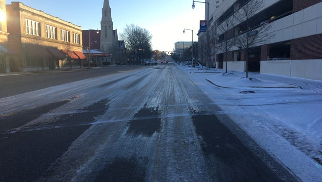 Ice covers Bibb Street by City Hall in downtown Thursday morning.