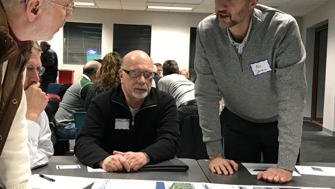 Community Development Director Nic Sparacio (far right) leads a group discussion about redeveloping areas of Manitowoc's downtown during the community workshop in January 2018.