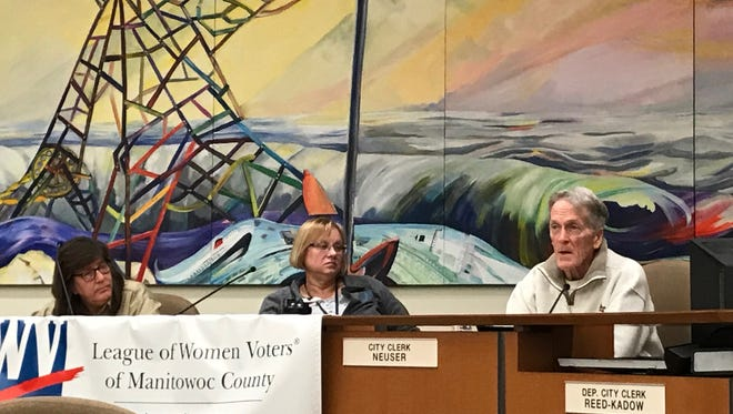 (From left) Yvonne Sharlein from the Emergency Food Assistance Program, Kim Loose from the Aging and Disability Resource Center and Woody Schulander from Peter's Pantry talk about hunger issues in Manitowoc County Thursday.