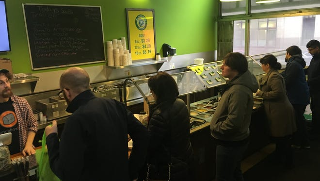 Customers line up at lunch time for soups and salads at the Green Room on January 22, 2018.