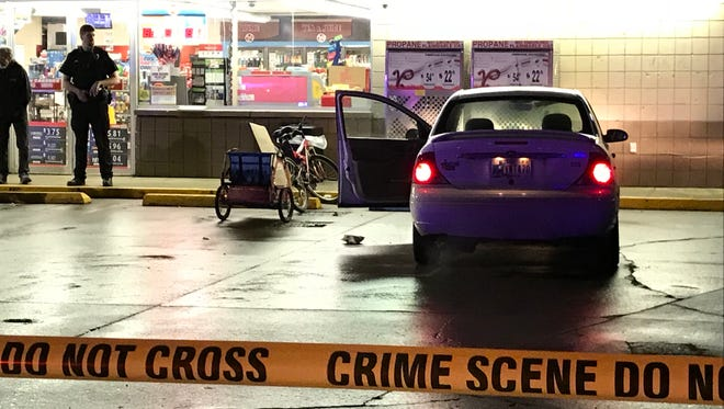 City police early Tuesday stand outside the Village Pantry at 2501 S. Macedonia Ave. after a man was shot in the store's parking lot shortly before midnight Monday.