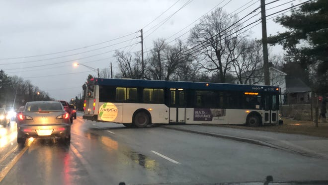 This is one of two IndyGo buses I saw sitting on the side of an icy Michigan Road Wednesday morning.