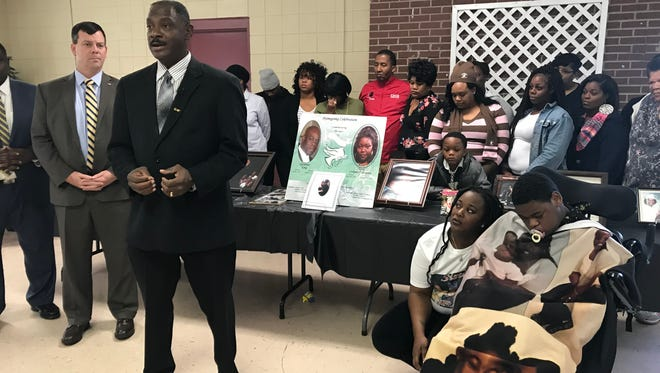 Montgomery City Councilman David  Burkette addresses media with the families of three Montgomery residents who died in a 2013 triple homicide.