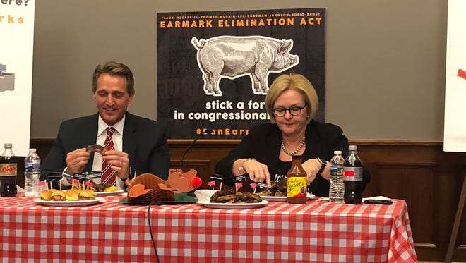 "Arizona Sen. Jeff Flake, a Republican, and Sen. Claire McCaskill, D-Mo., eat pork to protest Congressional ""earmarks"" in Washington, D.C. Jan. 24, 2018."