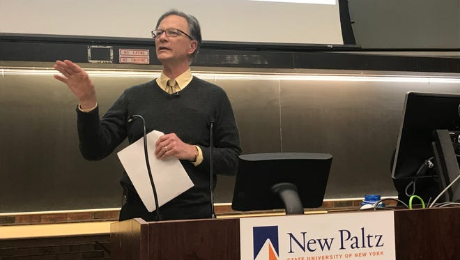 Reynolds Scott-Childress, co-chairman of the SUNY New Paltz Diversity & Inclusion Committee and a history professor, speaks Thursday night during a discussion of campus buildings named for local families that owned slaves.