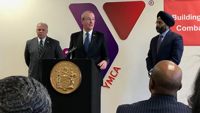 Gov. Phil Murphy, a Democrat, speaks at a news conference about gun control at the Trenton YMCA on Friday, Jan. 26, 2018. He is joined by Senate President Stephen Sweeney, D-Gloucester, left, and Attorney General Gurbir Grewal, right.