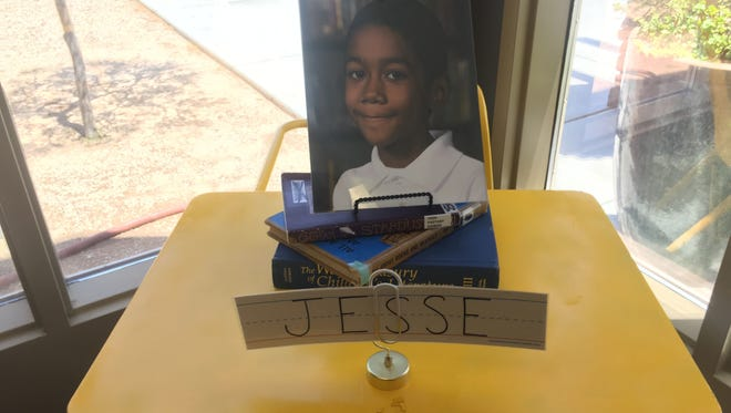 Jesse Wilson's picture sat in the front lobby of the school. He vanished July 17, 2016.
