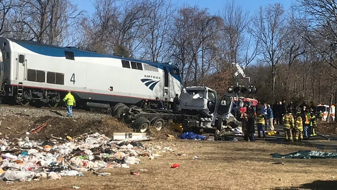 Emergency personnel work at the scene of a train crash involving a garbage truck Wednesday in Crozet, Virginia. An Amtrak passenger train carrying dozens of GOP lawmakers to a retreat in West Virginia struck a garbage truck outside Charlottesville, Virginia.