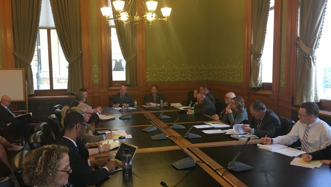 Members of an Iowa Senate subcommittee discuss a proposal to amend the Iowa Constitution to help crime victims.