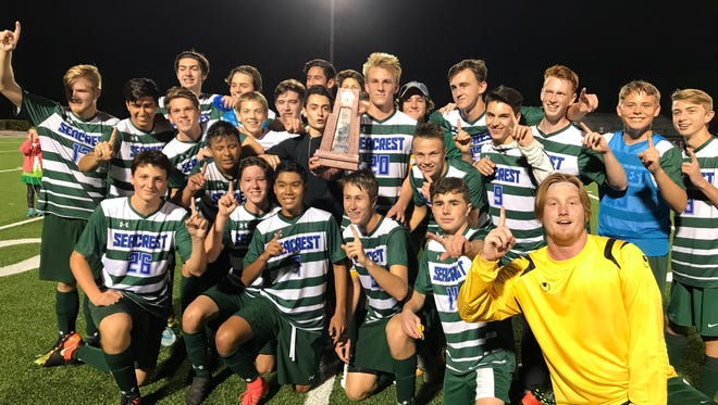 The Seacrest Country Day School boys soccer celebrates after winning the Class 1A-District 8 title, 1-0, over Canterbury on Friday, Feb. 2, 2018, at First Baptist Academy.