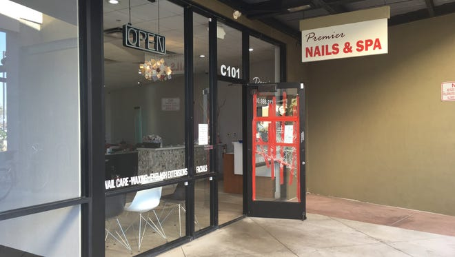 A note taped next to the broken door of the salon said the location was closed until further notice.
