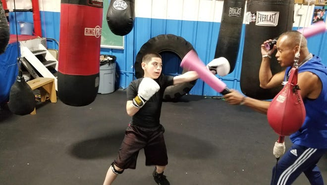 Chris Rodriguez trains with Coach Johnny Hernandez.