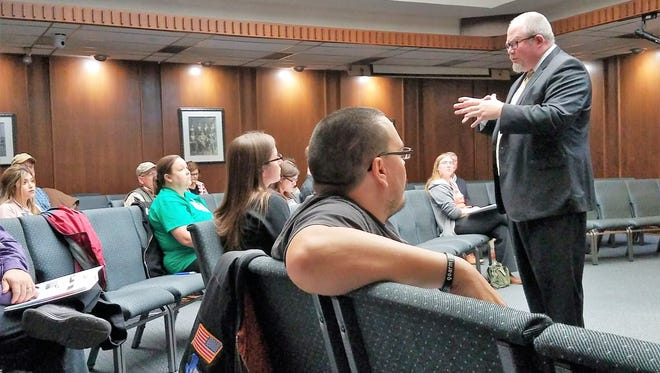 Abilene City Manager Robert Hanna talks with the members of Abilene Academy, a group of residents who will meet over nine weeks to learn about the city, its functions, and how they can participate.