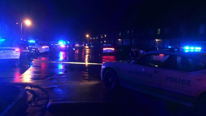 Memphis Police investigated the scene of a double shooting inside the Ashton Hills Apartments on the rainy night of February 6, 2018.