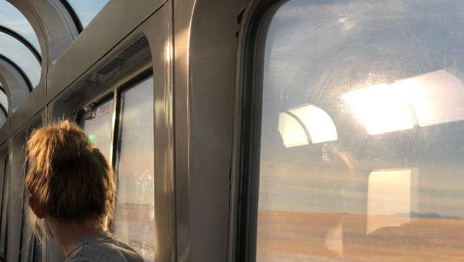 University High School freshman Rachel Zeh looks at the landscape from the observation car in an Amtrak train. A group of students from the Carmel private school were on the train for a nine-day trip across the country in January.