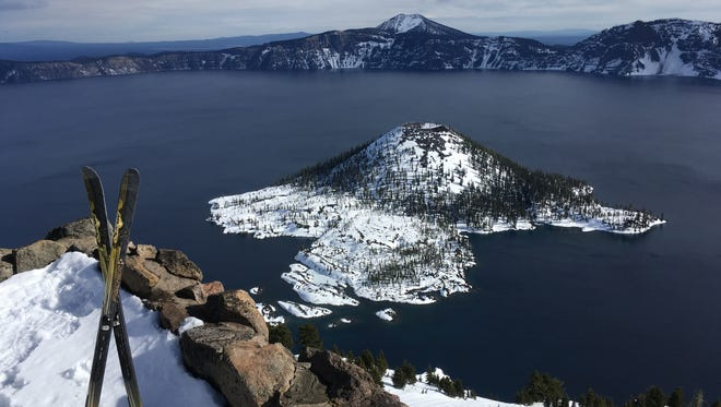 "Wizard Island is seen from The Watchtower. Snowshoers and skiers can trek to the tower on a ""kind of difficult"" trail."