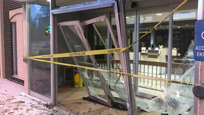 The exterior doors of the U.S. Bank near West 12th Street and South Western Avenue after a Thursday morning crash.