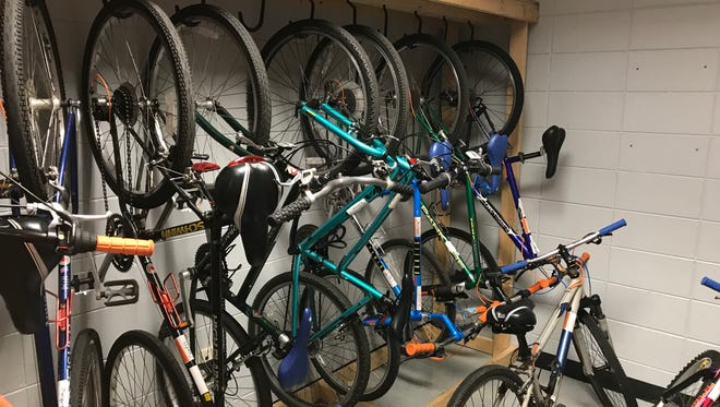 Bicycles are stored in a closet at Lakeview Middle School where the school's branch of Momentum Bike Club meets three times a week
