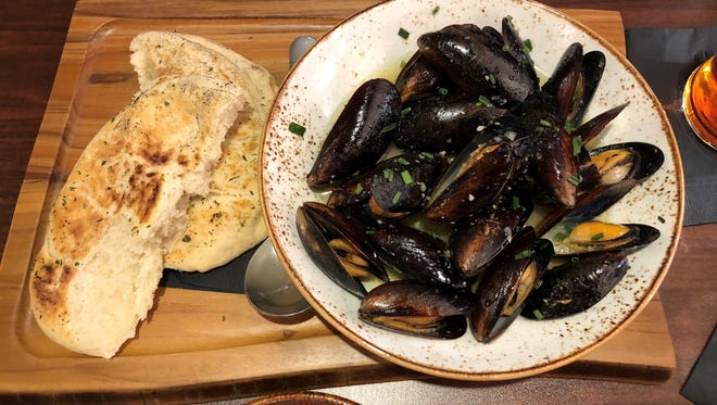 The Roasted Mussels appetizer with house bread.