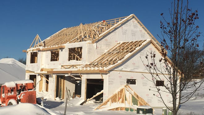 Home construction is off to a sluggish start in the new year, with building permits down 10% in January from 2017.