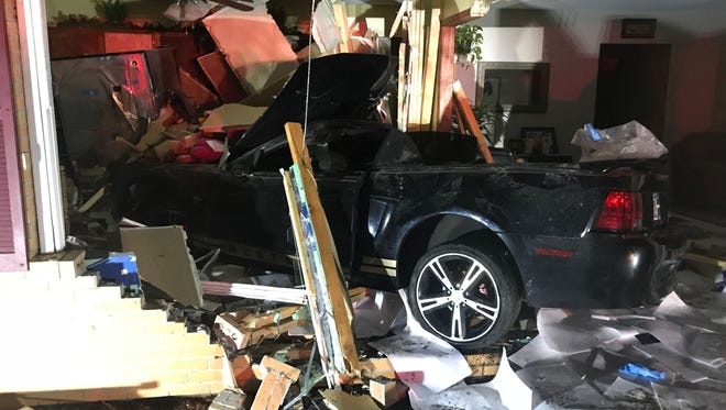 The Wayne Township Fire Department responded after a car drove into a home on the west side at Farley Drive and Doris Drive on Friday night.