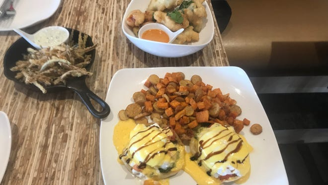 Zucchin straws with tzatziki sauce, tempura-battered peppadew and shishito peppers with lemon and cayenne dipping sauce and a Caprese-style eggs beenedict with roasted sweet potatoes and fingerling potatoes are pictured at Simmer in west Fort Collins.