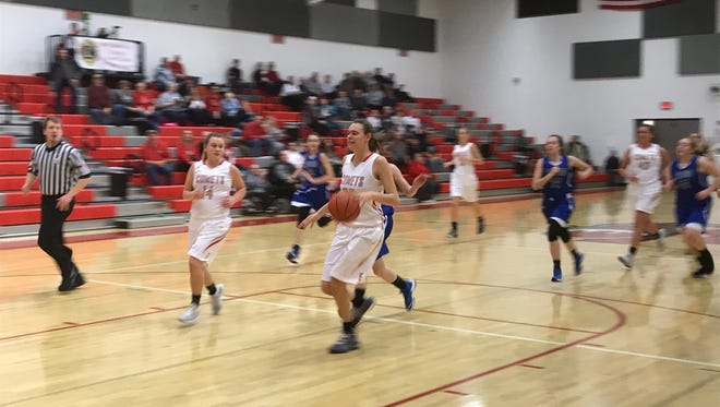 Elgin's Josi Wolf looks to finish a fastbreak during a nonleague game with Crestline earlier this season. The Comets went undefeated in the Northwest Central Conference in their first season in the league to win it.