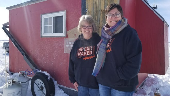 Cheryl Teichmiller and Heather Shanahan stand outside Teichmiller's shanty.