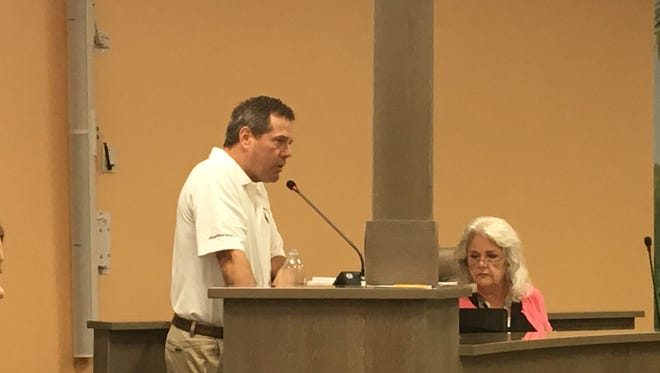 TPI Hospitality Chairman Tom Torgerson shares his vision for redevelopment with the town of Fort Myers Beach 's local planning agency on Tuesday, Feb. 13. Town Clerk Michelle Mayher looks on.